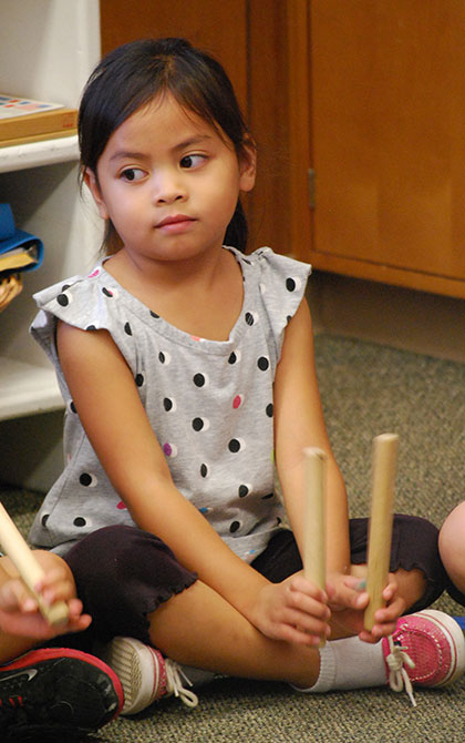 Beating rhythms with sticks at music time
